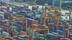 Thousands of steel shipping containers stacked in neat rows at the port Stock Footage