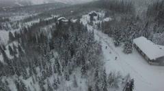 Skiers running - aerial Stock Footage
