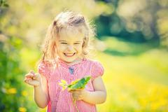 Stock Photo of Happy little girl in spring sunny park