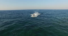 Video of speedboat with teens from above. Stock Footage