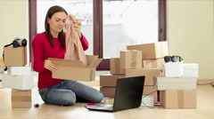 Young woman running on line clothing store packing goods for dispatch HD Stock Footage