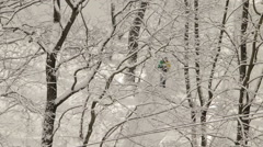 Man walking through the winter snowy park Stock Footage
