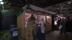 People buying Christmas products from stalls at the Christmas market, Frankfurt Stock Footage