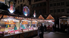 People buying candied fruits at the Christmas market in Frankfurt Stock Footage