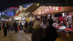 People passing by a clothing stall at the Christmas market in Frankfurt Stock Footage