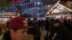 Two police officers among people at the Christmas market in Frankfurt Stock Footage
