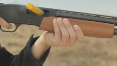 Slow Motion Firing and Pumping Shotgun Stock Footage
