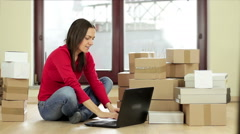 Woman doing on line shopping from laptop HD Stock Footage