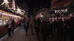 People wlaking by a big food stall at the Christmas market in Frankfurt Stock Footage