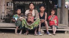 Burmese poor family sits on the street. Mrauk U, Myanmar, Burma - stock footage