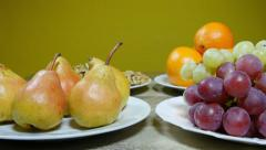 Different kinds of fruits on table, apple, grape, pear, close up, dolly Stock Footage