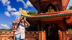 Closeup Old Man in Hat Photos Ancient Pagoda Tower Stock Footage