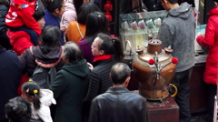 traditional tea soup pot in temple fair - stock footage