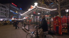 Parents with children coming from the carousel at Christmas market, Frankfurt - stock footage
