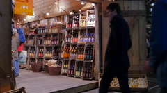 People entering a wine shop at the Christmas market in Frankfurt Stock Footage