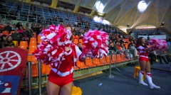 Girls cheerleaders with pom-poms in hands. Stock Footage