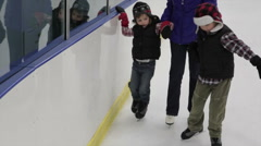 Kids Ice Skating In Indoor Rink Stock Footage