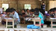 Burmese girls and boys in local school during lesson. Mrauk U, Myanmar, Burma Stock Footage