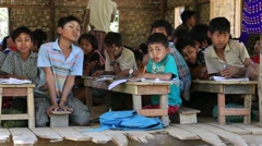 Burmese girls and boys in local school during lesson. Mrauk U, Myanmar, Burma Stock Footage
