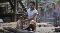 Burmese woman chopping wood in the yard. Mrauk U, Myanmar, Burma Stock Footage