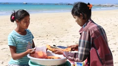 Burmese women selling fresh fruits at the Ngapali beach. Myanmar, Burma Stock Footage
