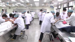 Students from Asia learn forensics - stock footage