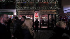 People walking by a cookie shop at Christmas in  in Frankfurt Stock Footage