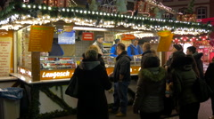 People buying Langos from a stall at the Christmas market in Frankfurt Stock Footage