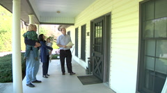 Family Looking At Home With Realestate Agent Stock Footage
