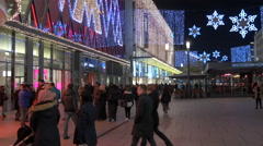 People walking by Weidenhof Restaurant on Zeil street on Christmas in Frankfurt Stock Footage