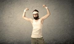 Young male showing muscles - stock photo