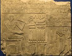 Ancient egyptian hieroglyphs on the wall - stock photo