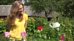 Villager woman hands show poppy flower red bloom hidden in arms. 4K Stock Footage