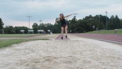 Female Athlete Practicing Long Jump Stock Footage