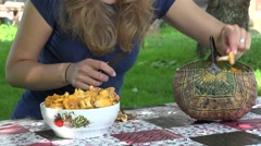 Female hands with knife clean chanterelle mushrooms on table. 4K Stock Footage