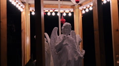 Angels sculptures spinning at the Christmas market in Frankfurt Stock Footage
