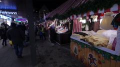 View of a soft goods stall at the Christmas market in Frankfurt Stock Footage
