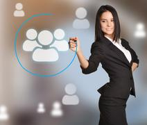 The girl from the Recruitment draws shield blue pen icons around team - stock photo