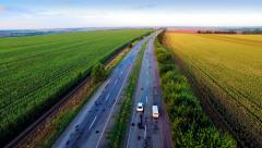 Aerial view of suburban road between fields - stock footage