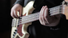Close up video of bass guitar playing Stock Footage