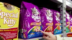 Woman buying Whiskas cat food inside Walmart store Stock Footage