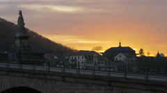 Beautiful view of a sunset and a woman walking on the Old bridge, Heidelberg Stock Footage