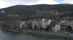 View of Heidelberg Castle and cars driving on the street near Neckar River Stock Footage