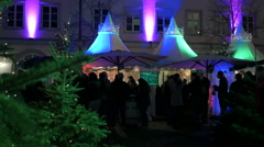 Tourists walking near street stalls at the Christmas market in Heidelberg Stock Footage