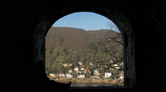 People taking pictures with the cityscape seen through window, Heidelberg Castle Stock Footage
