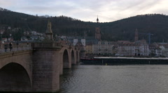 View of an industrial ship navigating under the Old Bridge in Heidelberg Stock Footage