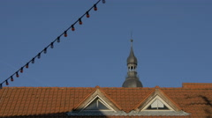 Bell tower of Church of Holy Spirit, a roof and a lights garland in Heidelberg Stock Footage