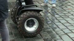 Segway huge wheels ride in a touristic public place in Old Town Square, Prague. Stock Footage