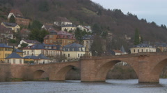Beautiful view of people walking on the Old Bridge at evening in Heidelberg Stock Footage