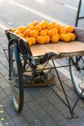 Fresh oranges on vintage wooden cart Stock Photos
